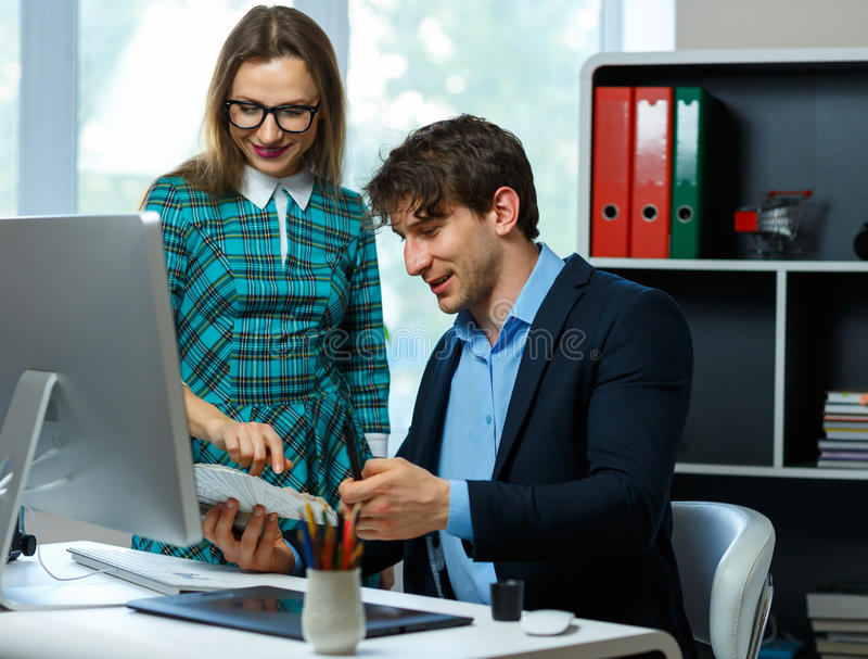 Beautiful young woman and man working from home. Beautiful young women and men working from home - modern business concept stock photography