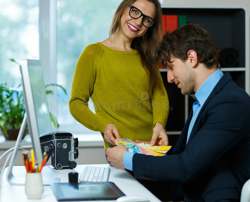 Beautiful young woman and man working from home. Beautiful young women and men working from home - modern business concept royalty free stock image