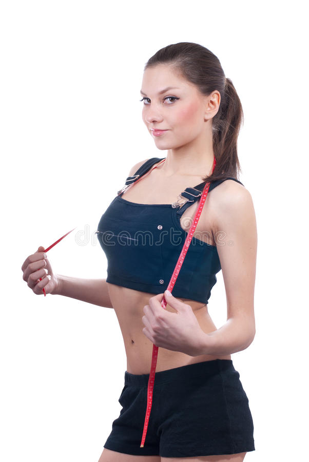 Beautiful Young Woman with measure tape isolated royalty free stock photography