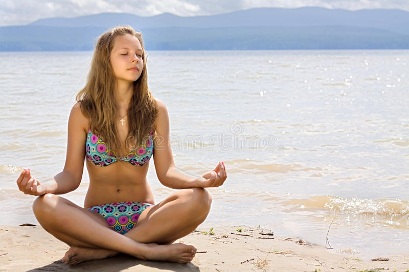 Download Beautiful Young Woman Meditation On Seacoast Royalty Free Stock Photography - Image: 16741647