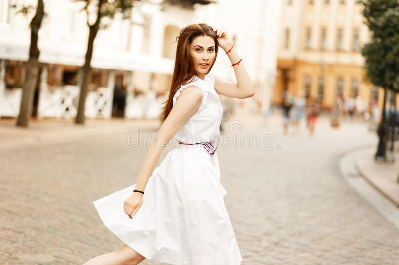 Beautiful young woman model in fashionable white dress royalty free stock image
