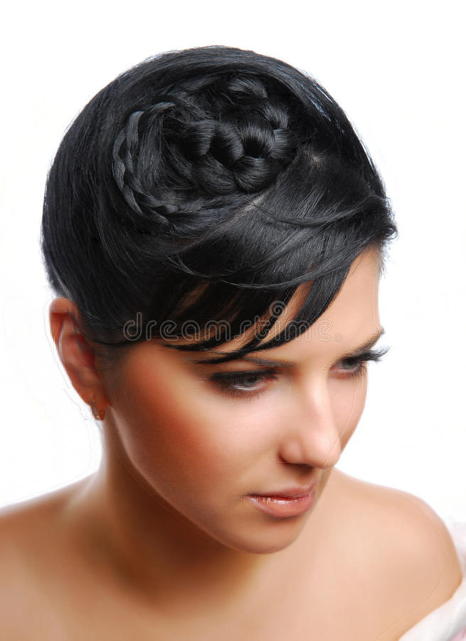 Beautiful young woman with modern hairstyle stock photo