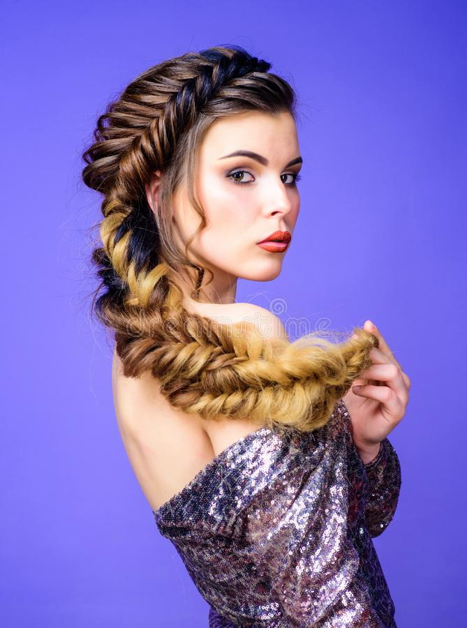 Beautiful young woman with modern hairstyle. Beauty salon hairdresser art. Girl makeup face braided long hair. French royalty free stock photos