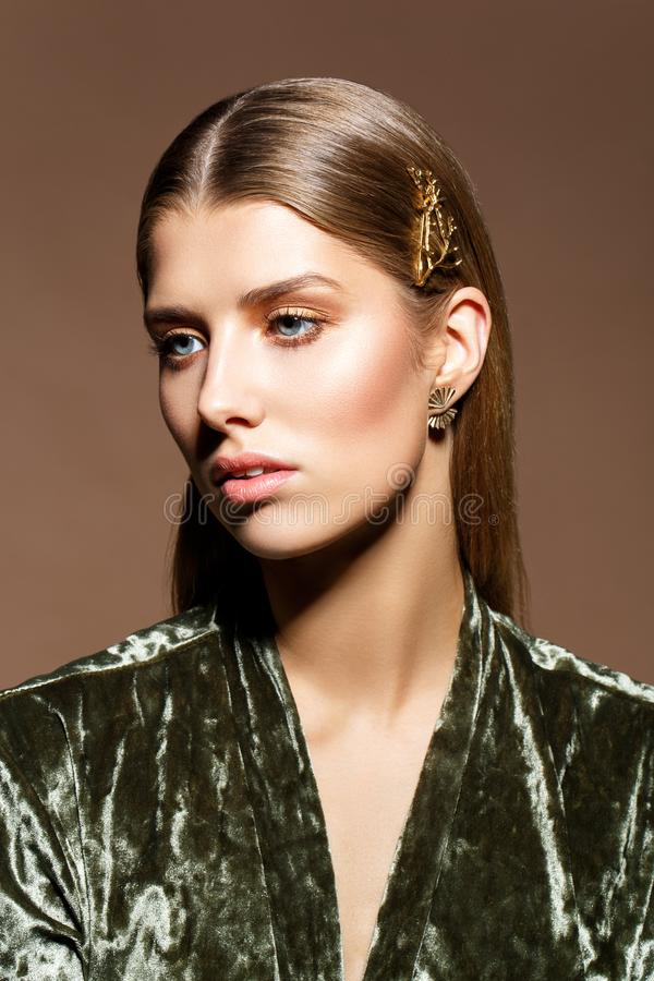 Beautiful girl with natural makeup and long hair royalty free stock image