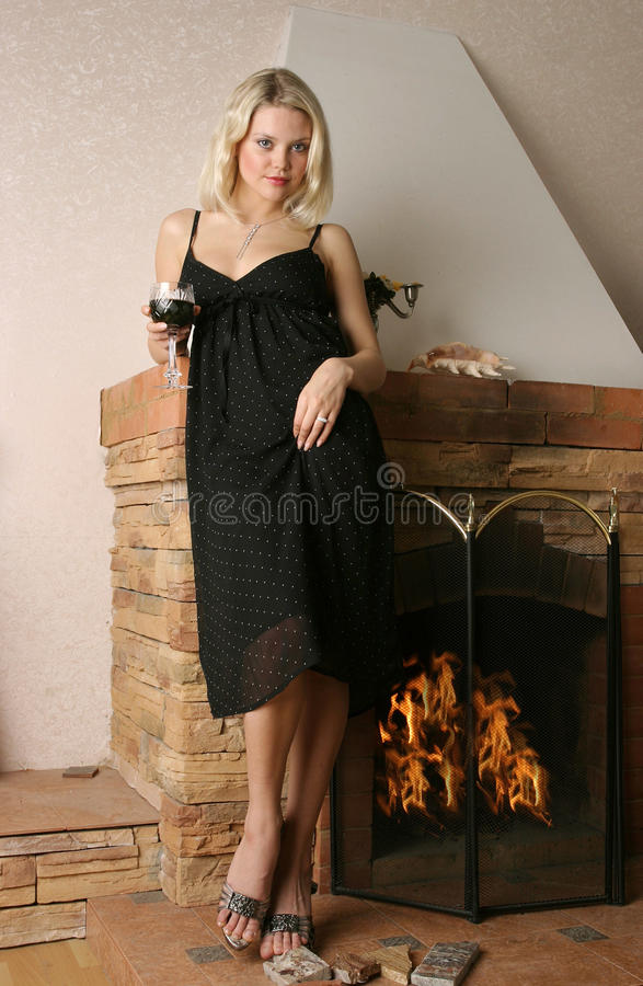 Free Beautiful Young Woman Near A Fireplace . Stock Images - 16795824