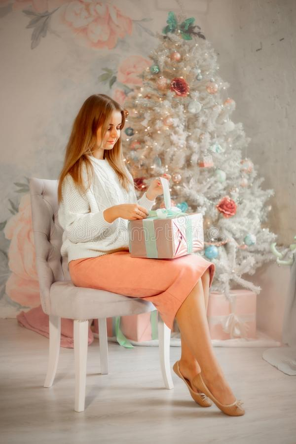 Beautiful young woman  at christmas eve royalty free stock photos