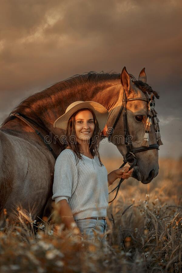 Free Beautiful  Young Woman On Spanish Buckskin Horse In Rue Field Royalty Free Stock Image - 194374196