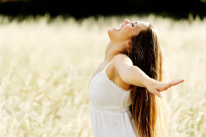 Beautiful young woman in an open field stock photos