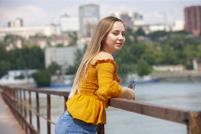 Beautiful Young Woman Outdoor. Enjoy Nature. Healthy Smiling Girl in the Spring Park. Sunny day royalty free stock images