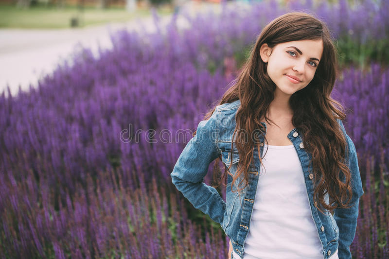 Beautiful young woman outdoor portrait. stock photography