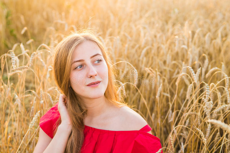 Beautiful Young Woman Outdoors. Enjoy Nature. Girl in the field. Beautiful Young Woman Outdoors. Enjoy Nature. Healthy Smiling Girl in the field stock images