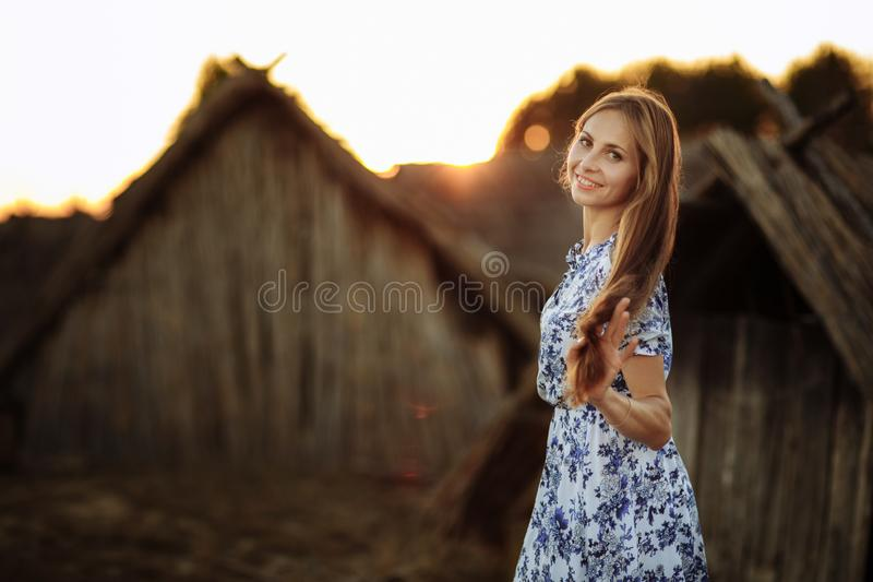 Beautiful Young woman outdoors portrait. Portrait of a beautiful girl against a tree house royalty free stock images