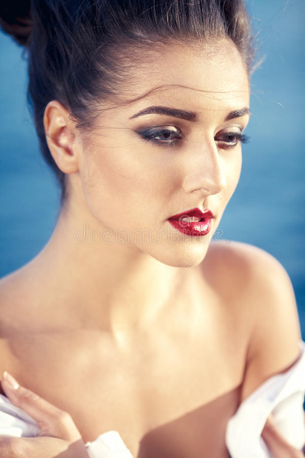 Beautiful Young Woman Outdoors Portrait Near The Sea stock images