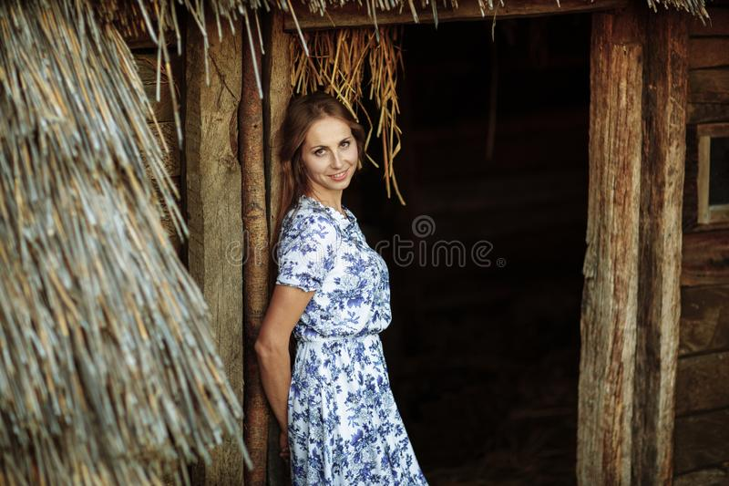 Beautiful Young woman outdoors portrait. Portrait of a beautiful girl against a tree house royalty free stock photos