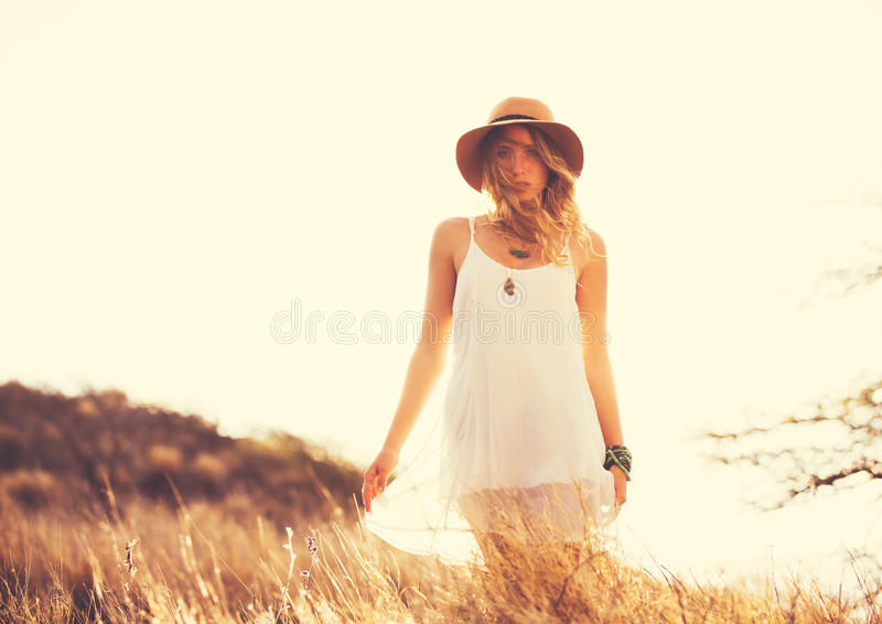 Beautiful Young Woman Outdoors. Soft warm vintage color. Fashion Lifestyle. Fashion Portrait of Beautiful Young Woman Outdoors. Soft warm vintage color tone stock photo