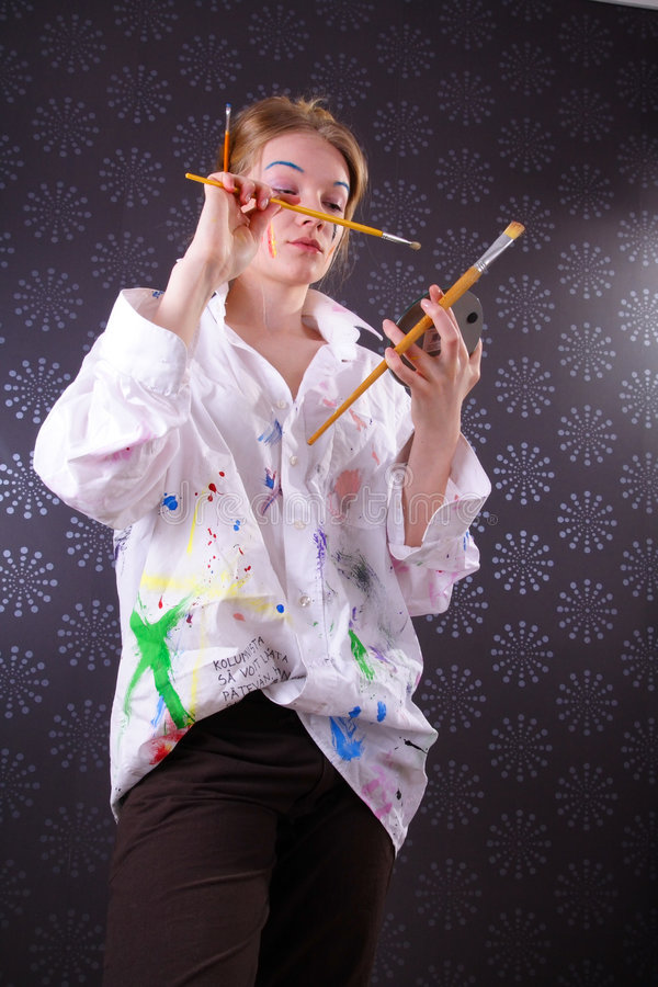 Beautiful young woman with paint on her face royalty free stock images