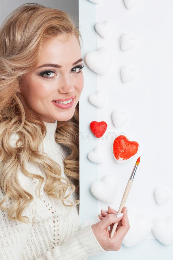 Woman painting hearts royalty free stock photos