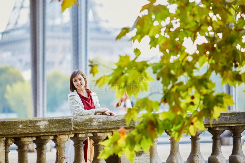 Young woman in Paris near the Eiffel tower royalty free stock photography