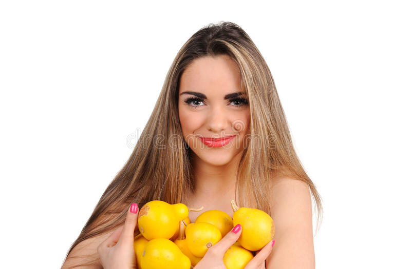 Beautiful young woman with pear royalty free stock image