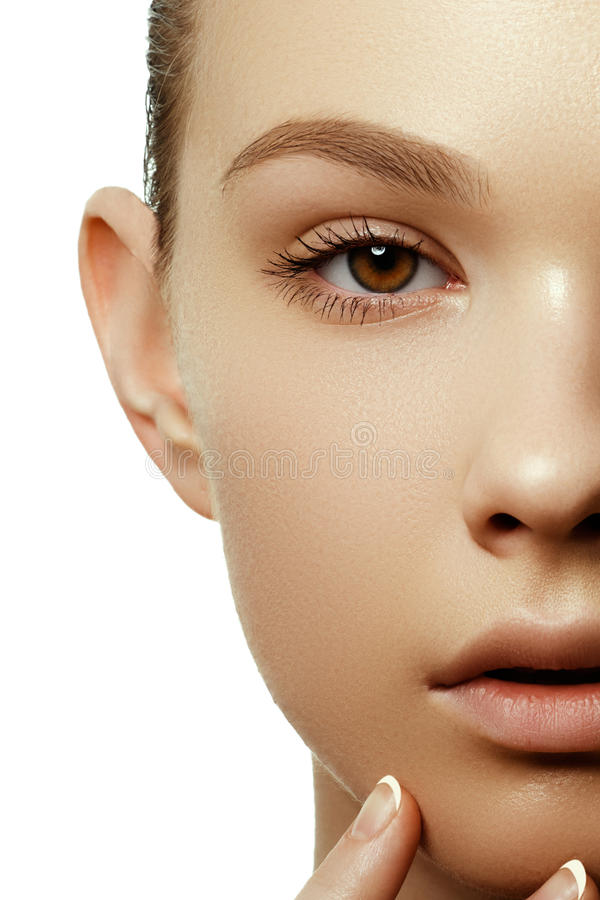 Beautiful young woman with perfect clean shiny skin, natural fashion makeup. Close-up woman, fresh spa look royalty free stock photography