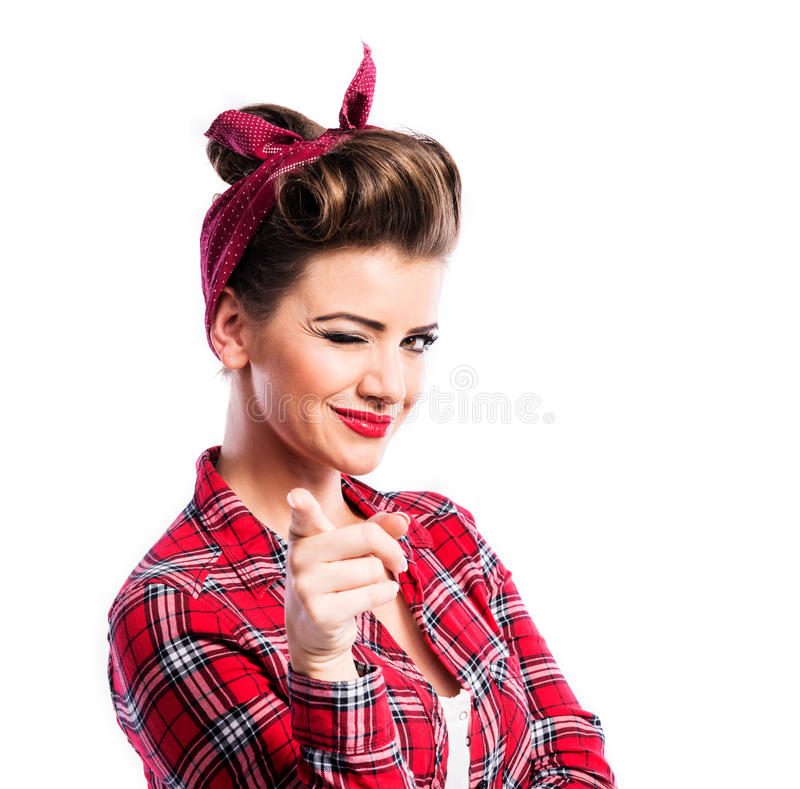 Beautiful young woman. With pin-up make-up and hairstyle. Studio shot on white background stock image