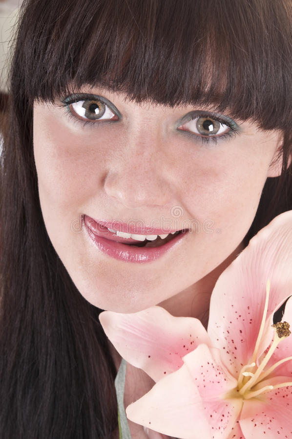 Beautiful young woman with pink flower. Portrait beautiful young woman with pink flower stock photo