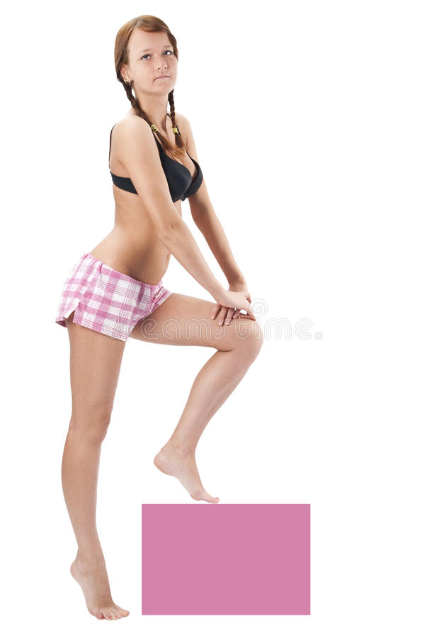 Beautiful young woman in pink shorts royalty free stock photos