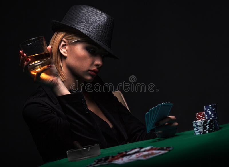 Beautiful young woman playing poker.  royalty free stock photo
