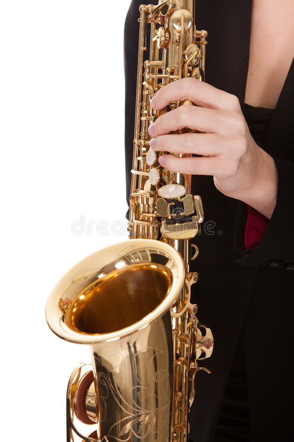 Beautiful young woman playing saxophone. Isolated on white stock photos