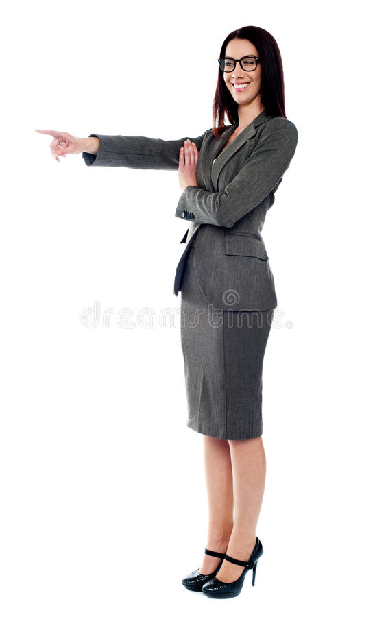 Beautiful young woman pointing to the right side royalty free stock photo