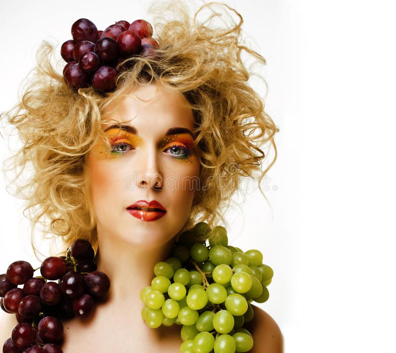 Beautiful young woman portrait excited smile with fantasy art hair makeup style, fashion girl with creative food fruit. Orange, grapes, citrus make up, happy stock photography