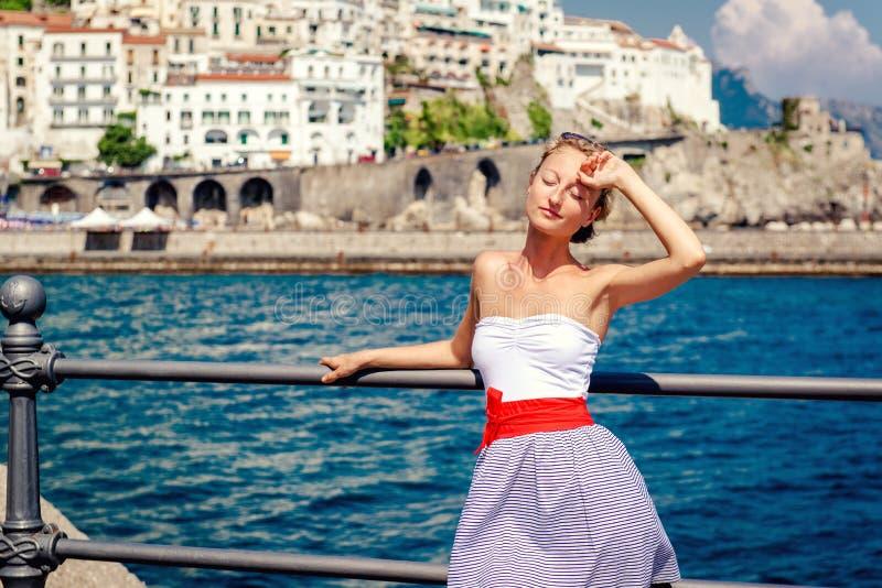 Beautiful young woman posing in Atrani town stock image