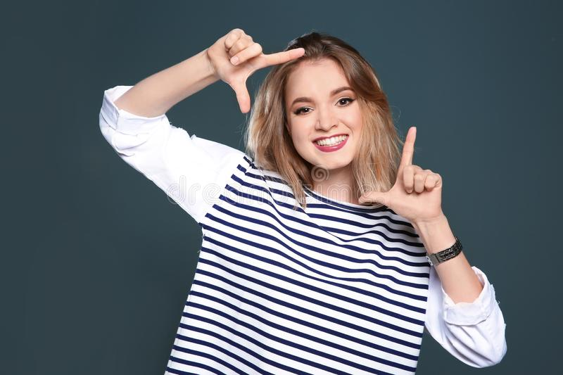 Beautiful young woman posin. G on color background stock photography