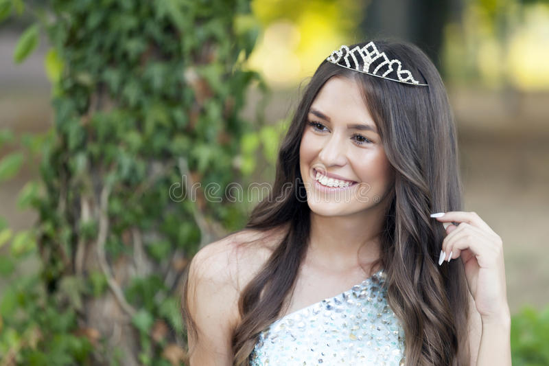 Beautiful young woman posing with a crown on her head stock images