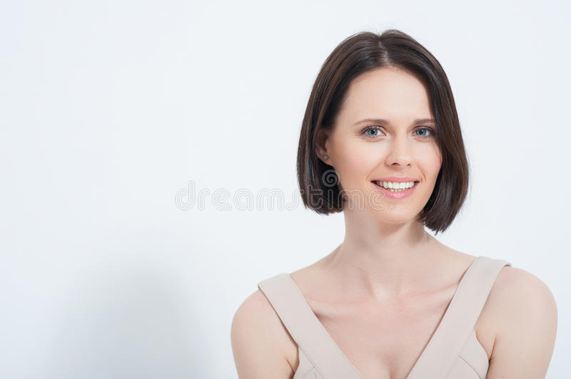 Beautiful young woman posing in dres royalty free stock photography