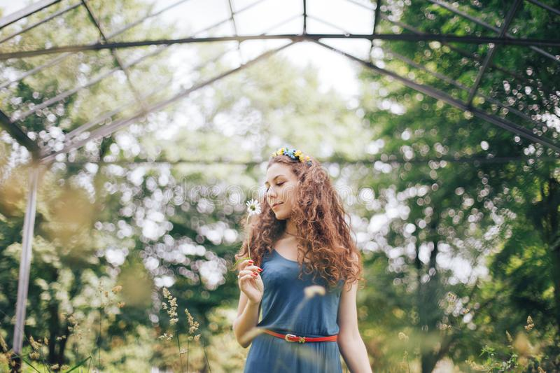 Beautiful young woman posing in the garden with blooming trees royalty free stock photos