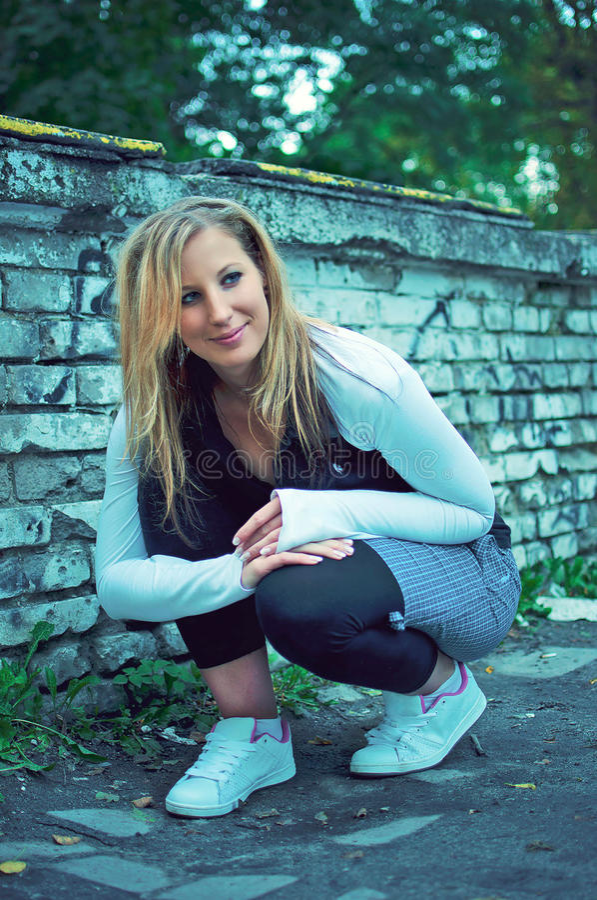 Beautiful Young Woman Posing Over Graffiti Wall Royalty Free Stock Images