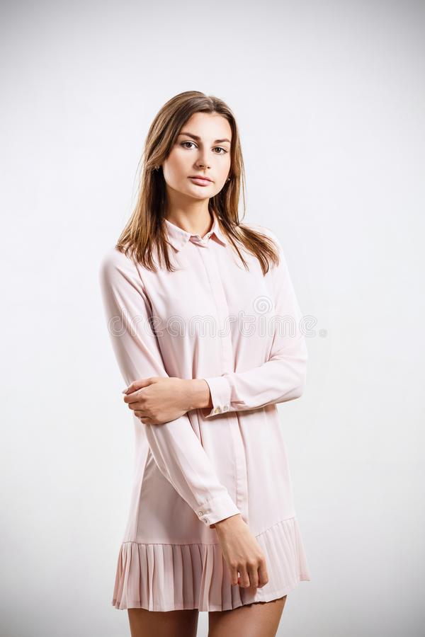 Beautiful young woman posing in romantic pink dress. stock image