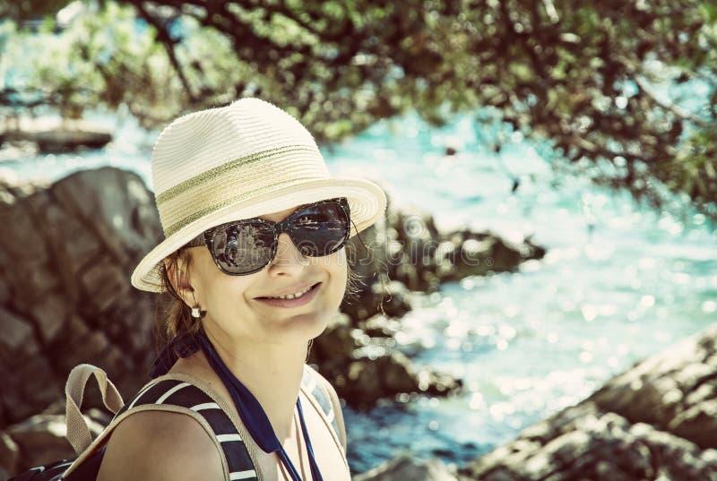 Beautiful young woman posing at the seashore, old filter royalty free stock photography