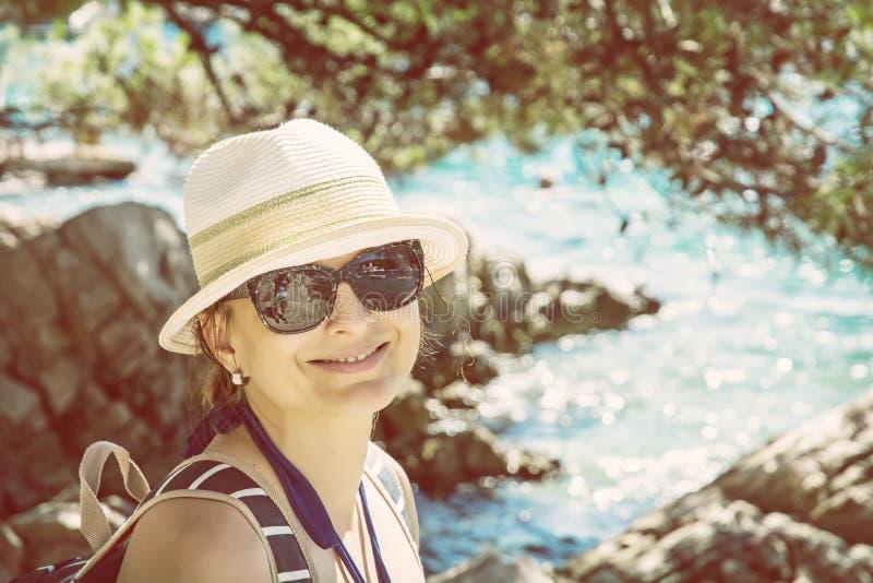Beautiful young woman posing at the seashore, Solta, beauty filter royalty free stock image