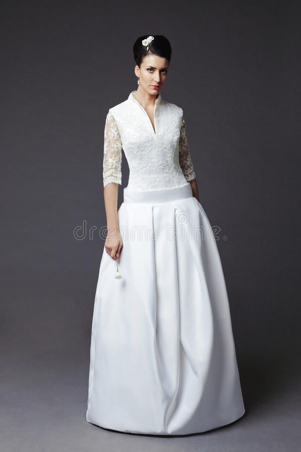 Beautiful young woman posing in a wedding dress royalty free stock photo