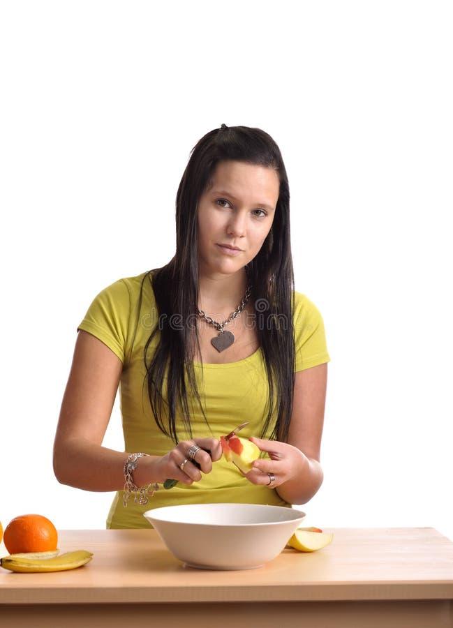 Beautiful Young Woman  Preparing A Fruit Salad Royalty Free Stock Photo