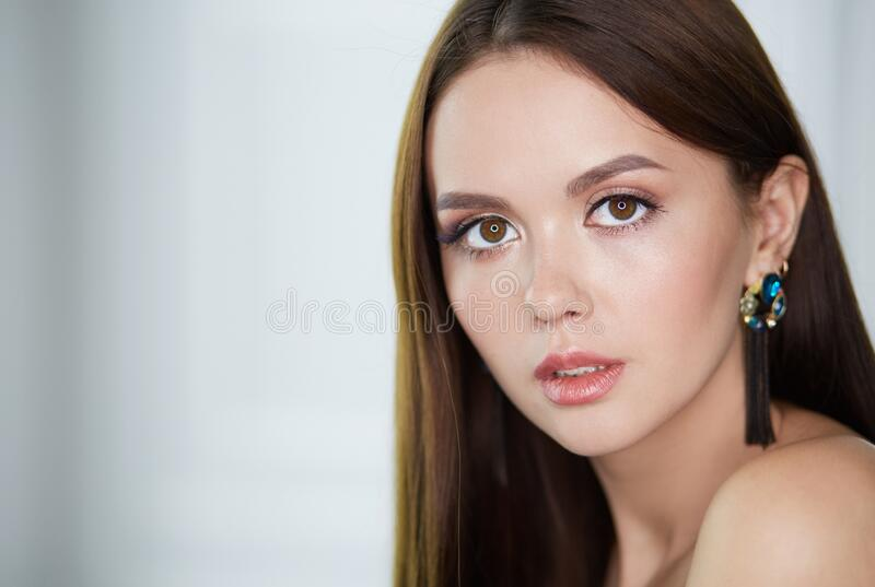 Beautiful young woman with professional make up.  stock photos
