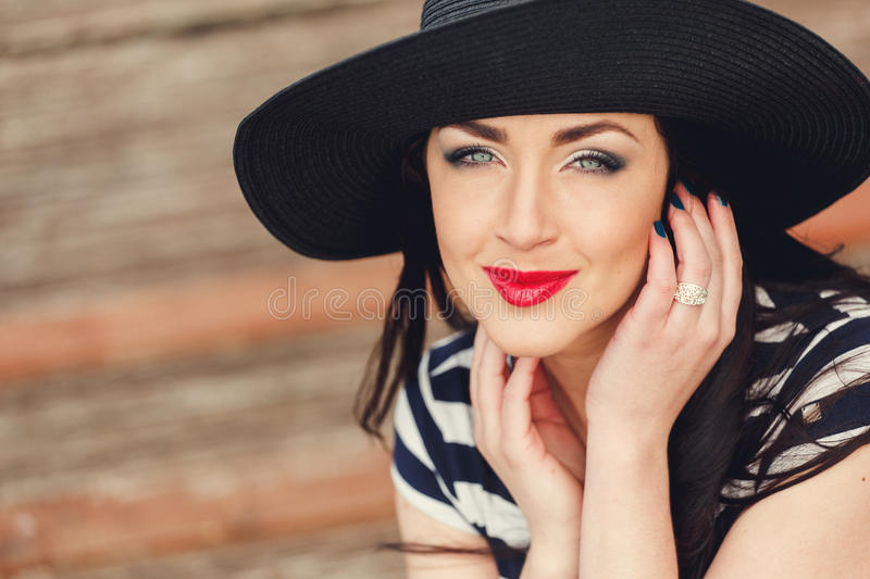Beautiful young woman. With professional make up, hair styling. Luxury accessory New Bright color makeup, shiny lipstick glossy co. Smetics. Young pretty photo stock image