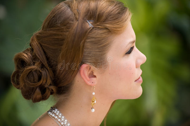 Beautiful young woman profile stock photos