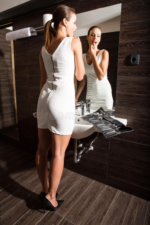 Beautiful Young Woman Putting On Makeup In The Bathroom Stock Image Image 50665673