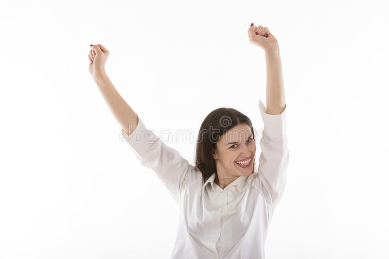 Beautiful young woman raising up hands stock images