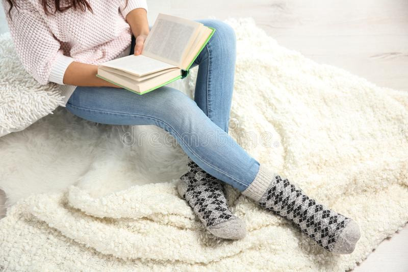 Beautiful young woman reading book royalty free stock photography