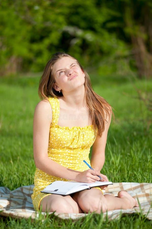 Beautiful Young Woman Reading Book Outdoor Stock Photos