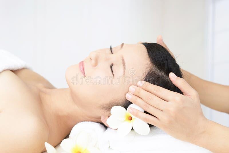 Beautiful young woman receiving facial massage stock image
